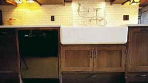 Cream coloured subway tiles compliment the dark wood cabinets.