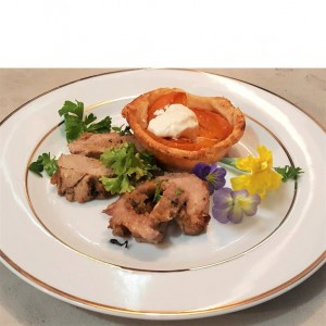 APRICOT TART BAKED SUGARED STEWED PITTED APRICOTS OVER A FLAKY CRUST, CREAM , PUT ON TOP CRUST   COLLARDED ROLLED PORK  ROAST WITH A STUFFING MADE OF BREADCRUMBS, MILK, NUTMEG, PEPPER, SALT, THYME, PARSLEY, AND BOILED CHOPPED CUCUMBERS
